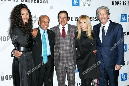 Eskedar Gobeze, from left, Berry Gordy, Smokey Robinson, Rosanna Arquette and Todd Morgan attend the 2015 City of Hope's Annual Spirit of Life Gala held at the Santa Monica Civic Auditorium, in Santa Monica, Calif