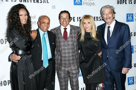 Stock Picture of Eskedar Gobeze, from left, Berry Gordy, Smokey Robinson, Rosanna Arquette and Todd Morgan attend the 2015 City of Hope's Annual Spirit of Life Gala held at the Santa Monica Civic Auditorium, in Santa Monica, Calif