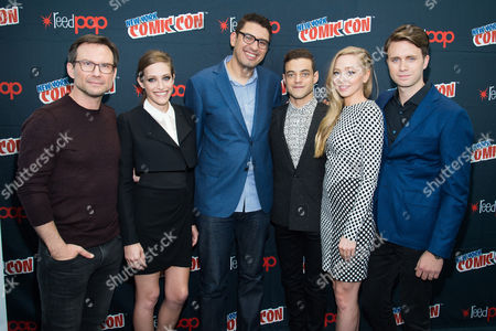"""Christian Slater, left, Carly Chaikin, Sam Esmail, Rami Malek, Portia Doubleday and Martin Wallstrom attend a press event for USA Networks's """"Mr. Robot"""" at the 2015 New York Comic Con at the Javits Center, in New York"""