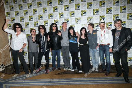 """Stock Image of From left, Tommy Thayer, Eric Singer, Paul Stanley, Gene Simmons, Matthew Lillard, Grey Griffin, Pauley Perrette, Kevin Shinick, Spike Brandt, and Tony Cervone attend the """"Scooby-Doo! and KISS: Rock and Roll Mystery"""" press line on day 1 of Comic-Con International, in San Diego"""