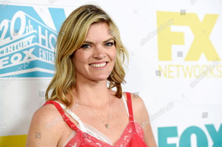 """Missy Pyle, a cast member on the television series """"Bordertown,"""" poses at the Fox/FX/10th Century Fox TV/Fox International Channels Comic-Con Party, in San Diego, Calif"""