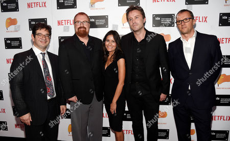 "Rebecca Brando, center, daughter of the late actor Marlon Brando, poses with, left to right, Peter Ettedgui, co-writer of the documentary film ""Listen to Me Marlon,"" the film's co-producer R.J. Cutler, director/writer Stevan Riley and co-producer John Battsek at the 2015 IDA Documentary Awards at Paramount Studios, in Los Angeles"