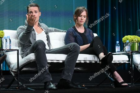 """Actors Alexander Dreymon, left, and Emily Cox speak onstage during the """"The Last Kingdom"""" panel at the BBC America 2015 Summer TCA Tour held at the Beverly Hilton Hotel on in Beverly Hills, Calif"""