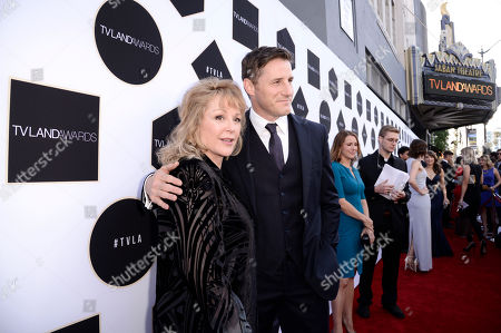 Bonnie Bedelia, left, and Sam Jaeger arrive at the TV Land Awards at the Saban Theatre, in Beverly Hills, Calif