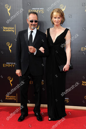 Stock Picture of Lev L. Spiro, left, and Melissa Rosenberg arrives at night one of the Creative Arts Emmy Awards at the Microsoft Theater, in Los Angeles