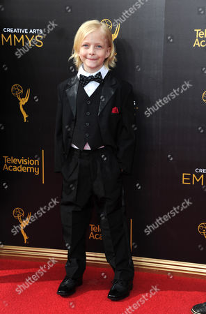 Christian Ganiere arrives at night one of the Creative Arts Emmy Awards at the Microsoft Theater, in Los Angeles