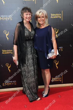 Stock Image of Stephanie Gorin, left, and Jackie Lind arrives at night one of the Creative Arts Emmy Awards at the Microsoft Theater, in Los Angeles
