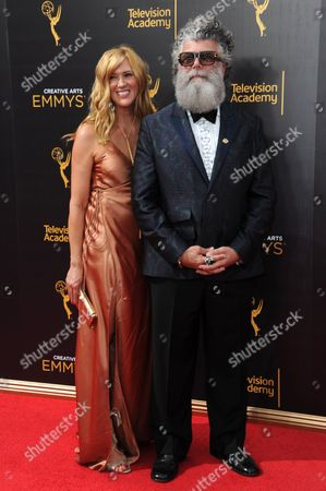Stock Image of Crescenzo Notarile, right, arrives at night one of the Creative Arts Emmy Awards at the Microsoft Theater, in Los Angeles