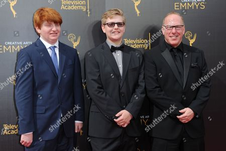 Stock Image of Luke Blutman, from left, Liam Blutman and Mark Blutman arrive at night one of the Creative Arts Emmy Awards at the Microsoft Theater, in Los Angeles