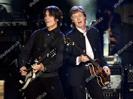 Paul McCartney, right, performs alongside guitarist Rusty Anderson on day 2 of the 2016 Desert Trip music festival at Empire Polo Field, in Indio, Calif