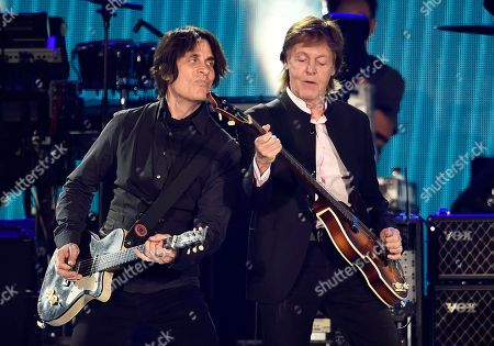 Paul McCartney, right, performs alongside guitarist Rusty Anderson during his performance on day 2 of the 2016 Desert Trip music festival at Empire Polo Field, in Indio, Calif