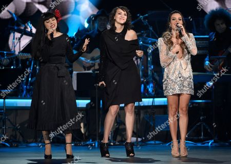 """Mon Laferte, from left, Gaby Moreno, and Kany Garcia perform """"You Sang To Me"""" at the Latin Recording Academy Person of the Year Tribute honoring Marc Anthony at the MGM Grand Garden Arena, in Las Vegas"""