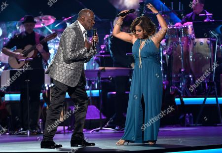 "Johnny Ventura, left, Milly Quezada perform ""Tu Amor Me Hace Bien"" at the Latin Recording Academy Person of the Year Tribute honoring Marc Anthony at the MGM Grand Garden Arena, in Las Vegas"
