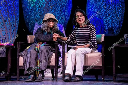 Sonia Sanchez, left, and Dolores Huerta speak on board the Norwegian Escape during day 1 of the Summit at Sea cruise on in Miami