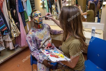 Alexa Meade, right, paints on Lil Buck, before a performance on board the Norwegian Escape during day 1 of the Summit at Sea cruise on in Miami