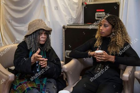 Sonia Sanchez, left, and Aja Monet prepare to speak on board the Norwegian Escape during day 1 of the Summit at Sea cruise on in Miami
