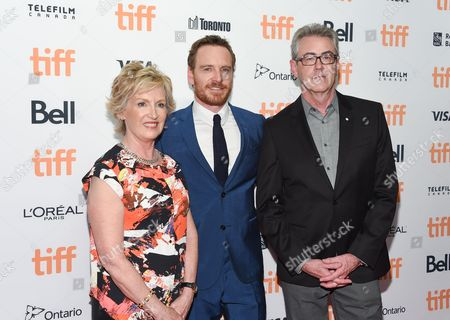 Stock Picture of Chair of TIFF board of directors, Lisa de Wilde, actor Michael Fassbender and TIFF director and CEO, Piers Handling, attend the TIFF Soiree, an annual fundraiser and celebratory kick-off for the 2016 Toronto International Film Festival, at the TIFF Bell Lightbox, in Toronto