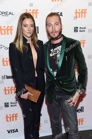 Stock Photo of Charlotte Fisher and Adam Moryto attend the TIFF Soiree, an annual fundraiser and celebratory kick-off for the 2016 Toronto International Film Festival, at the TIFF Bell Lightbox, in Toronto