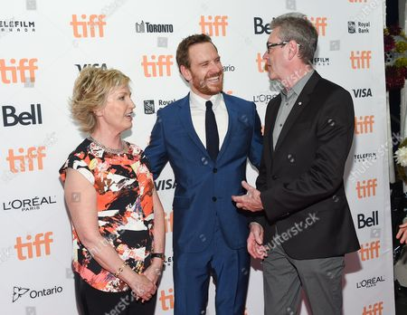 Stock Photo of Chair of TIFF board of directors, Lisa de Wilde, actor Michael Fassbender and TIFF director and CEO, Piers Handling, attend the TIFF Soiree, an annual fundraiser and celebratory kick-off for the 2016 Toronto International Film Festival, at the TIFF Bell Lightbox, in Toronto