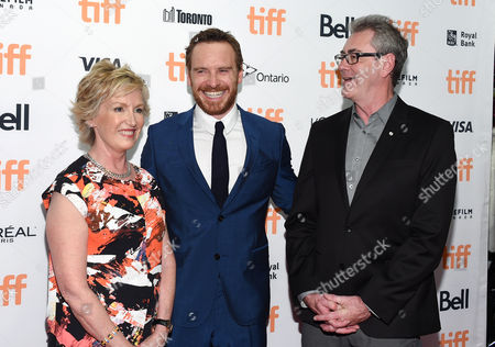 Chair of TIFF board of directors, Lisa de Wilde, actor Michael Fassbender and TIFF director and CEO, Piers Handling, attend the TIFF Soiree, an annual fundraiser and celebratory kick-off for the 2016 Toronto International Film Festival, at the TIFF Bell Lightbox, in Toronto
