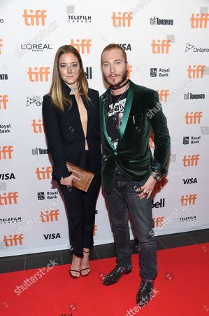 Stock Image of Charlotte Fisher and Adam Moryto attend the TIFF Soiree, an annual fundraiser and celebratory kick-off for the 2016 Toronto International Film Festival, at the TIFF Bell Lightbox, in Toronto