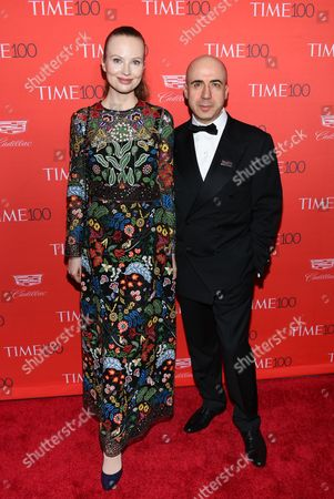 Russian entrepreneur Yuri Milner, right, and wife Julia Milner attend the TIME 100 Gala, celebrating the 100 most influential people in the world, at Frederick P. Rose Hall, Jazz at Lincoln Center, in New York