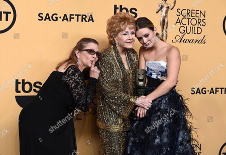 Carrie Fisher, from left, Debbie Reynolds, winner of the Screen Actors Guild lifetime award, and Billie Catherine Lourd pose in the press room at the 21st annual Screen Actors Guild Awards at the Shrine Auditorium, in Los Angeles