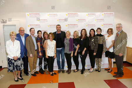 Stock Picture of From left, Phyllis Komansky, David Komansky, Dr. Cam Patterson, Erica Silverman, Sara DiPasquale, Celia Nichols, Naomi Watts, Liev Schreiber, Mindy Webster, Susan Frehse, Jessica Kisling, Dr. Barbara Landreth, Kathleen Burns and Dr. Gerald M. Loughlin attend the 25th Anniversary of Light A Life benefiting the NewYork-Presbyterian Komansky Center for Children's Health at Chelsea Piers on Saturday, Oct.18, 2014, in New York