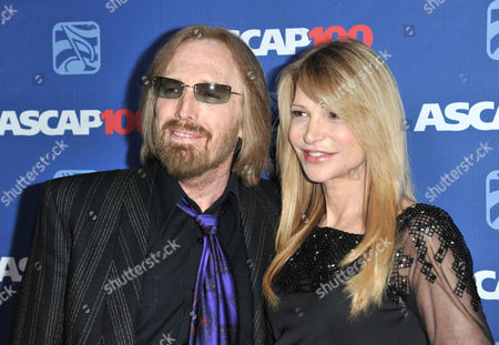 Stock Photo of Tom Petty, left, and Dana York arrive at the 31st Annual ASCAP Pop Music Awards at the Loews Hollywood Hotel, in Los Angeles