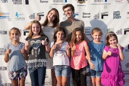 Bailee Madison, left above, and Mavrick Moreno with fans attend the 31st annual Fort Lauderdale International Film Festival at Savor Cinema on Friday, Nov.11, 2016 in Fort Lauderdale, Fla