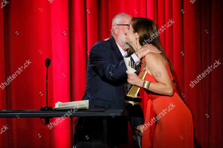Robert David Hall presents Kristin Leffler with The Loreen Arbus Focus on Disability Scholarship award at the 35th College Television Awards, presented by the Television Academy Foundation at The Leonard H. Goldenson Theatre in the NoHo Arts District, in Los Angeles