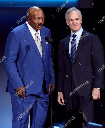 Stock Picture of Former NFL player Jim Brown, left, and Scott Pelley introduce the Pro Football Hall of Fame class of 2016 at the 5th annual NFL Honors at the Bill Graham Civic Auditorium, in San Francisco
