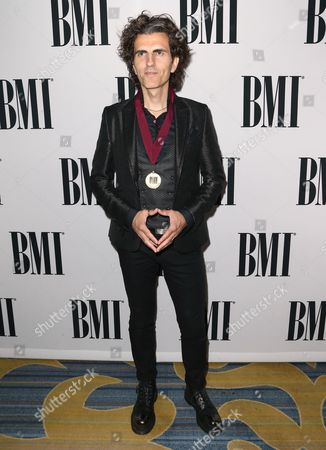 """Stephan Moccio, winner of the BMI Pop Award for """"Earned It"""" performed by The Weeknd, arrives at the 64th annual BMI Pop Awards at the Beverly Wilshire Hotel, in Beverly Hills, Calif"""