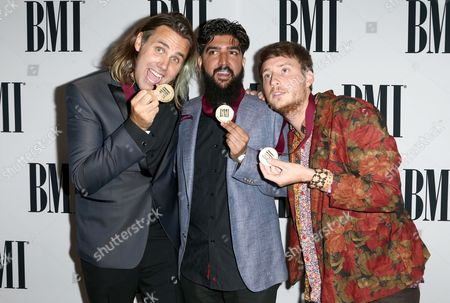 "Stock Picture of Jason Evigan, from left, Ammar Malik, and Danny Parker, winners of the BMI Pop Award for ""Chains"" performed by Nick Jonas, arrive at the 64th annual BMI Pop Awards at the Beverly Wilshire Hotel, in Beverly Hills, Calif"