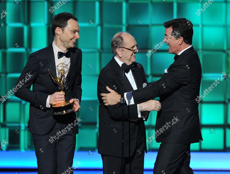 """Stock Image of From left, Jim Parsons and Bob Newhart present the award for outstanding writing for a variety series to Steven Colbert for """"The Colbert Report"""" at the 65th Primetime Emmy Awards at Nokia Theatre, in Los Angeles"""
