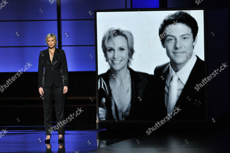 Jane Lynch presents a tribute to Cory Monteith on stage at the 65th Primetime Emmy Awards at Nokia Theatre, in Los Angeles