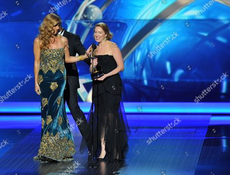"""From left Connie Britton and Blair Underwood present the award for outstanding writing for a drama series to Sarah Bromell who accepts on behalf of her late husband Henry Bromell for his work on """"Homeland"""" at the 65th Primetime Emmy Awards at Nokia Theatre, in Los Angeles"""
