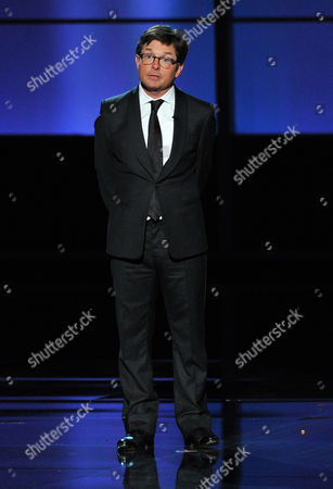 Michael J. Fox presents a tribute to Gary David Goldberg, who is featured on screen at right at the 65th Primetime Emmy Awards at Nokia Theatre, in Los Angeles