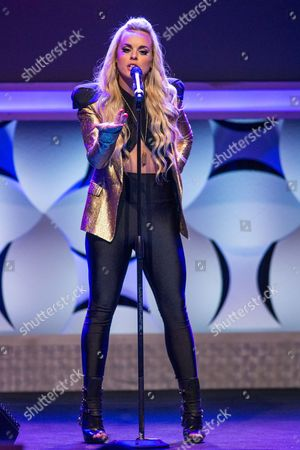 Katy Tiz performs onstage during the 6th Annual Thirst Gala at The Beverly Hilton Hotel on in Beverly Hills, Calif