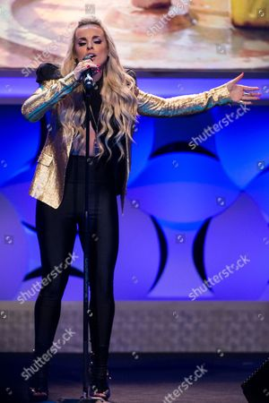 Stock Image of Katy Tiz performs onstage during the 6th Annual Thirst Gala at The Beverly Hilton Hotel on in Beverly Hills, Calif