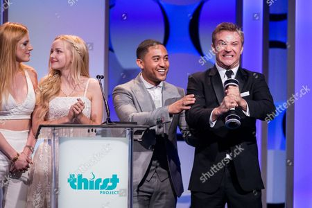 From left, Bella Thorne, Dove Cameron, Tahj Mowry and Michael Welch speak onstage during the 6th Annual Thirst Gala at The Beverly Hilton Hotel on in Beverly Hills, Calif