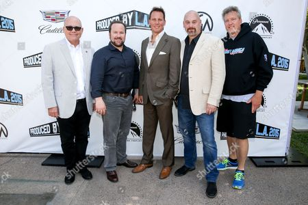 Stock Image of Tim Gibbons, from left, Brent Montgomery, Brant Pindivic, Craig Armstrong and Chris Moore pose at the 7th Annual Produced By Conference presented by Producers Guild of America at Paramount Pictures Studios on in Los Angeles