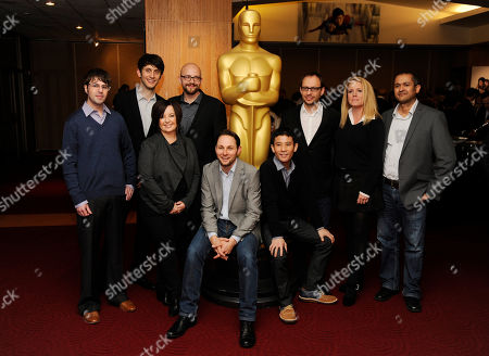 Animated Short Film Oscar nominees, from left, Dan Golden, Jan Lachauer, Dorothy McKim, Max Lang, Alexandre Espigares, Shuhei Morita, Laurent Witz, Selma Vilhunen and Daniel Sousa pose together at a reception featuring the Oscar nominees in the Animated and Live-Action Short Film categories, in Beverly Hills, Calif. The Oscars will be held on Sunday at the Dolby Theatre in Los Angeles