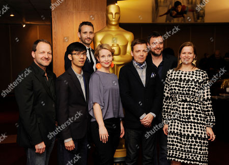 Live Action Short Film Oscar nominees, from left, Kim Magnusson, Baldwin Li, Anders Walter, Kirsikka Saan, Mark Gill, Esteban Crespo and Selma Vilhuenen pose together at a reception featuring the Oscar nominees in the Animated and Live-Action Short Film categories, in Beverly Hills, Calif. The Oscars will be held on Sunday at the Dolby Theatre in Los Angeles