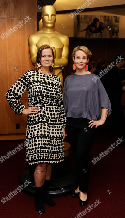 """Selma Vilhunen, left, director of the Oscar-nominated Finnish live-action short film """"Do I Have to Take Care of Everything?"""" and the film's writer Kirsikka Saari pose together at a reception featuring the Oscar nominees in the Animated and Live-Action Short Film categories, in Beverly Hills, Calif. The Oscars will be held on Sunday at the Dolby Theatre in Los Angeles"""