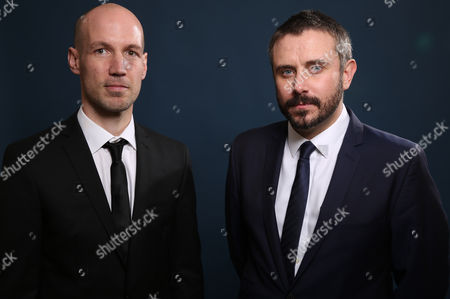 Rick Rowley and Jeremy Scahill pose for a portrait at the 86th Oscars Nominees Luncheon, on Monday, Feb.10, 2014 in Beverly Hills, Calif