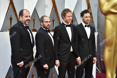 Gabor Rajna, from left, Gabor Sipos, Laszlo Nemes, and Geza Rohrig arrive at the Oscars, at the Dolby Theatre in Los Angeles