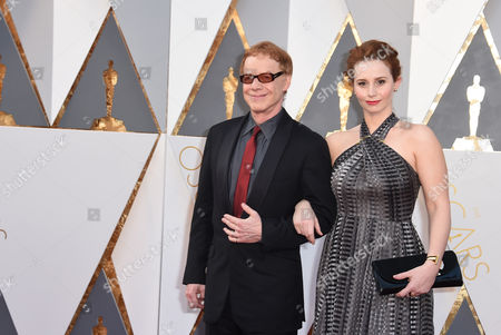 Danny Elfman, left, with daughter Mali Elfman arrive at the Oscars, at the Dolby Theatre in Los Angeles