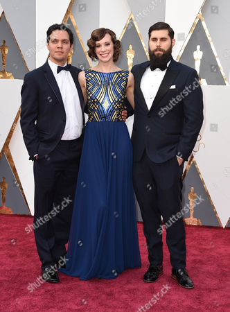 Shan Christopher Ogilvie, from left, Chloe Pirrie and Michael Paleodimos arrive at the Oscars, at the Dolby Theatre in Los Angeles