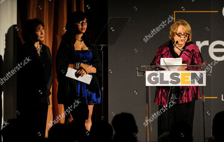 Linda Bloodworth-Thomason, right, accepts the Lifetime Achievement Award as presenter Lily Tomlin, far left, looks on at the 9th Annual Gay, Lesbian & Straight Education Network Respect Awards at The Beverly Hills Hotel on in Beverly Hills, Calif
